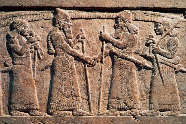 origem do aperto de mão